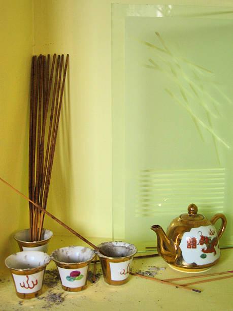 Ornate tea pot with incense stock photo