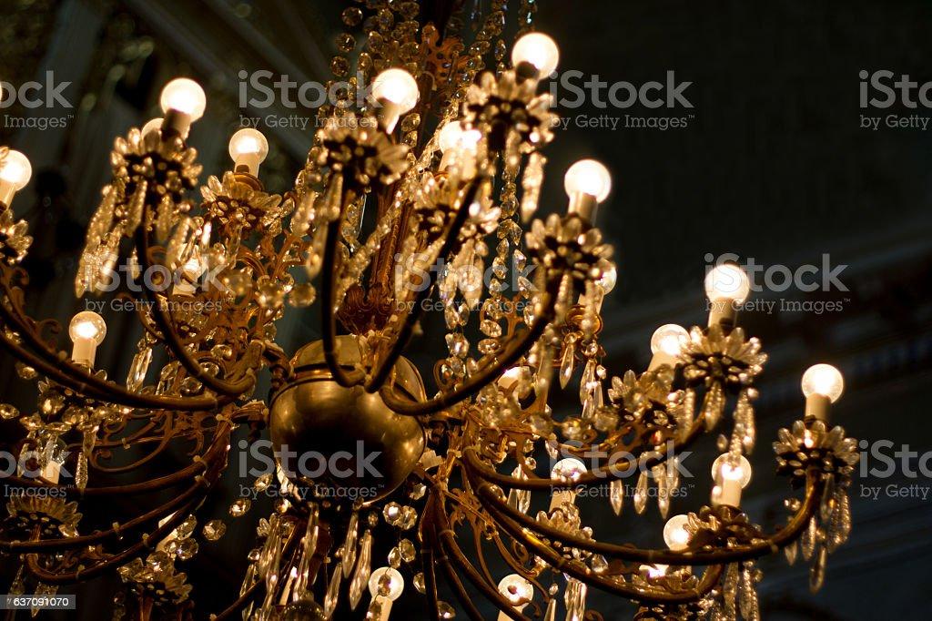 Ornate Vintage Illuminated Gold Chandelier Black Background Close Up Royalty Free