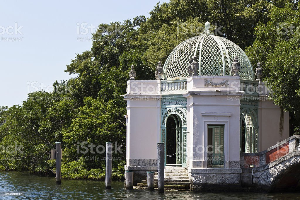 Ornate waterfront building in a garden stock photo