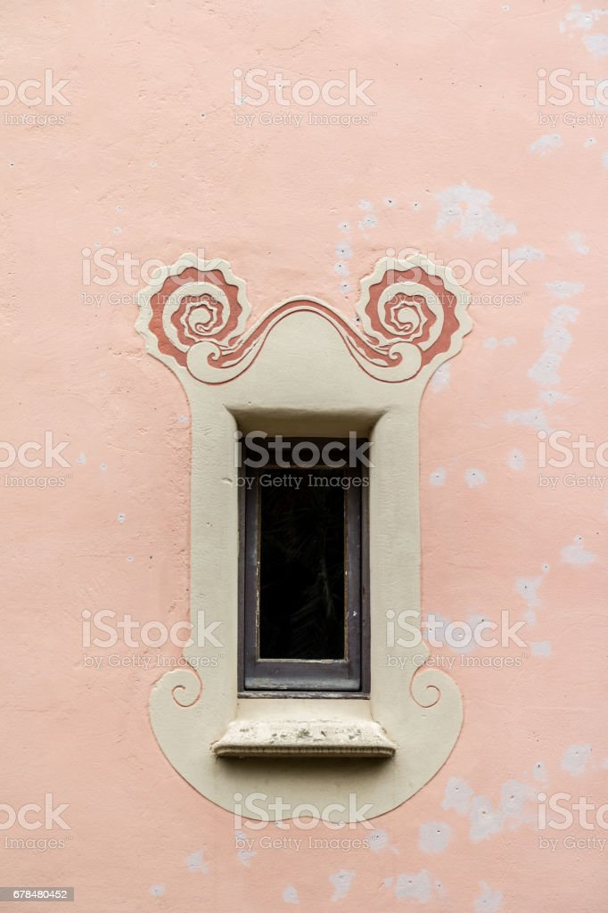 ornate window on pink wall royalty-free stock photo