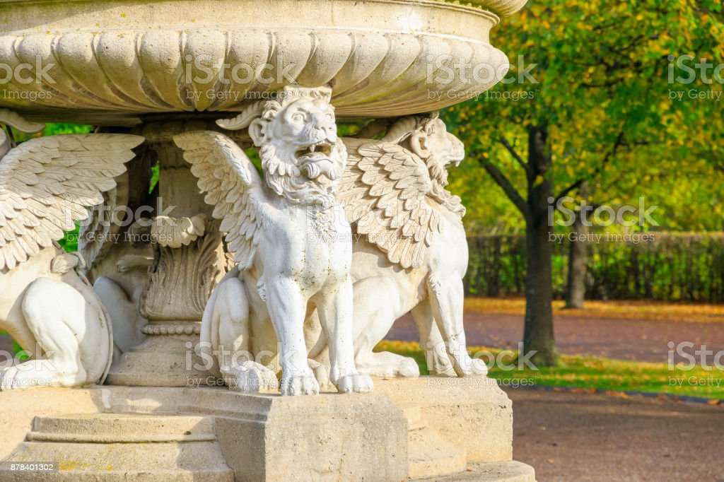 Ornate winged stone lions in Regent's Park of London stock photo