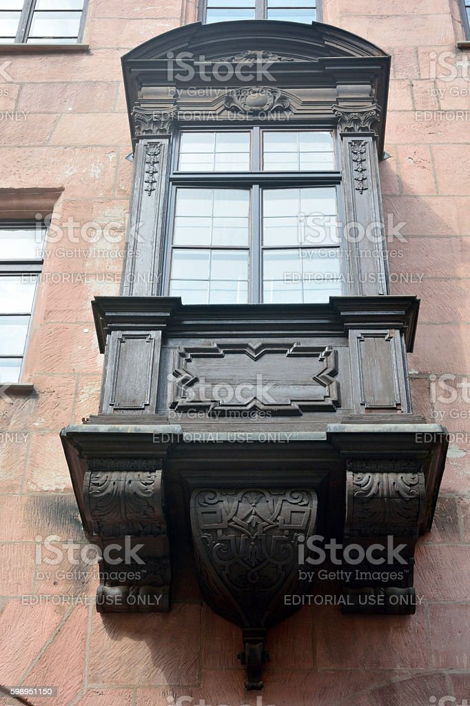 Ornate wooden balcony in Nuremberg, Germany. stock photo