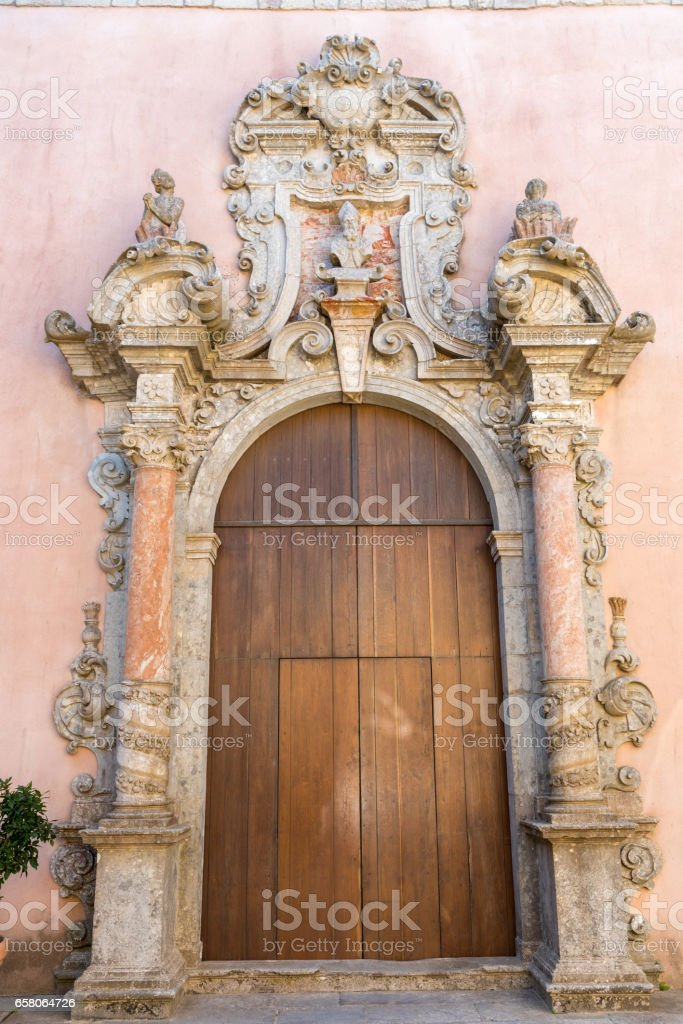 Ornated door seen in Erice Sicily royalty-free stock photo