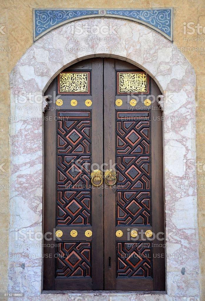 Ornately decorated wood brass inlay door Sarajevo mosque Bosnia Hercegovina stock photo