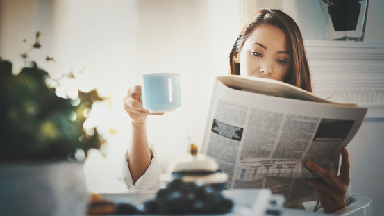 M orning routine with coffee and newspapers.