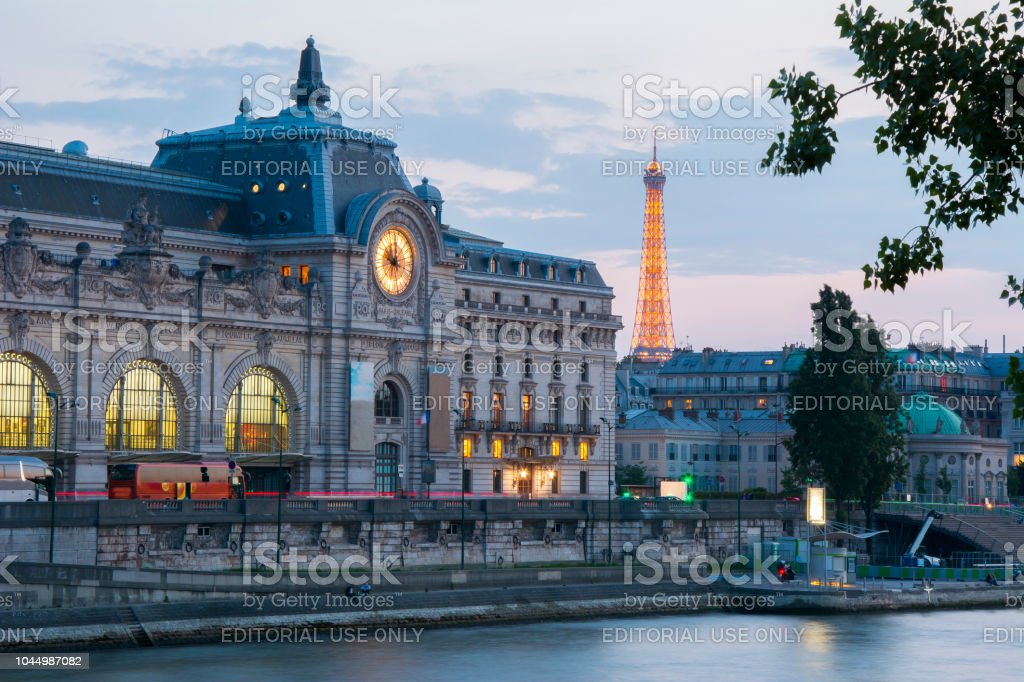 Orsay Museum And Eiffel Tower At Sunset Paris France Stock