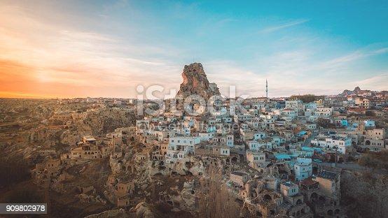 istock Ortahisar cave city in Cappadocia, Turkey on sunset 909802978