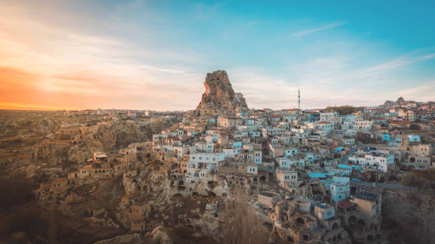 ortahisar cave city in cappadocia, turkey on sunset - turkey middle east stock pictures, royalty-free photos & images