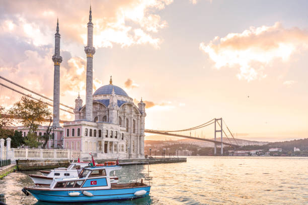 Ortakoy Mosque in Istanbul Colorful Ortakoy mosque and Bosphorus Bridge in the background. bosphorus stock pictures, royalty-free photos & images