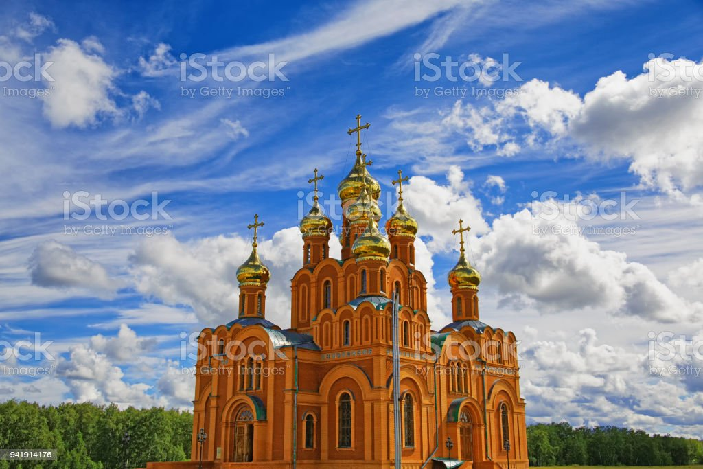 Orthodox cathedral against the background of the majestic sky stock photo