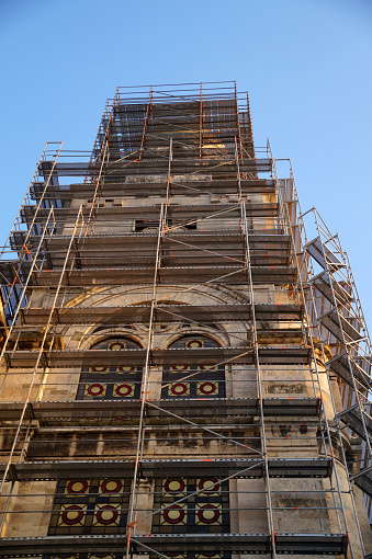 orthodox cathedral in scaffolding on a background of blue sky