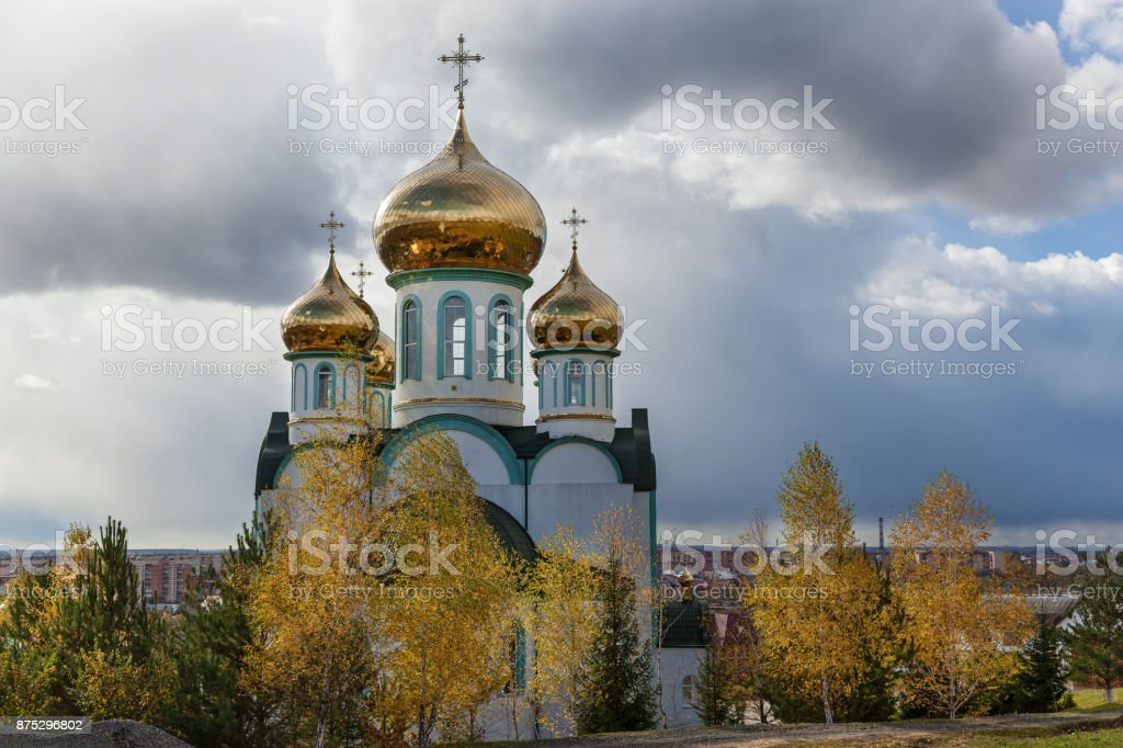 orthodox church with golden domes stock photo