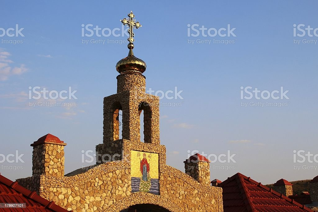 Orthodox cross and icon at sunset royalty-free stock photo