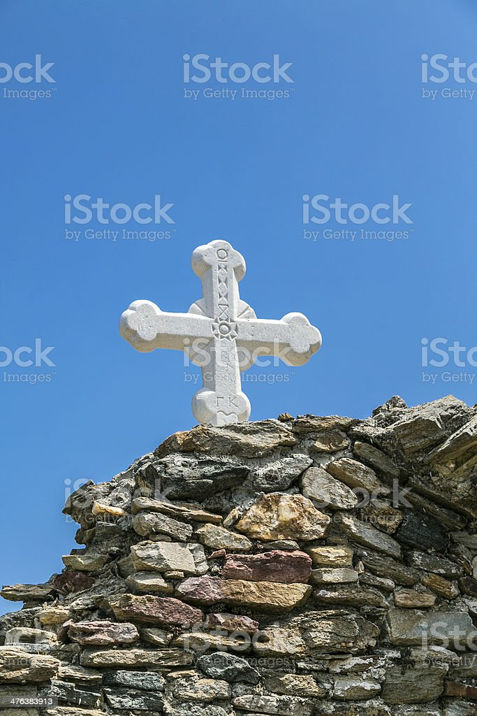 orthodox cross at an ancient wall stock photo