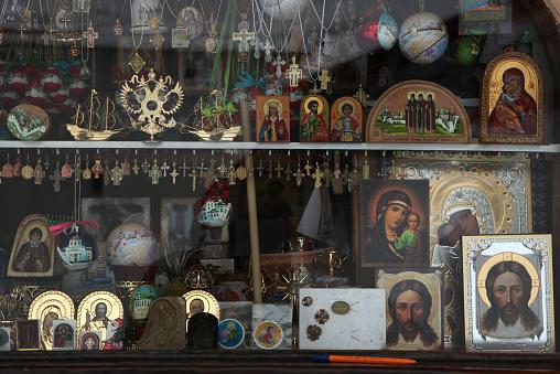 Pechory, Russia - January 25, 2011: Orthodox icons in a icon shop in the Pskovo-Pechersky Monastery (Pskov Monastery of the Caves) in the town of Pechory near Pskov, Russia.
