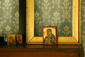Three orthodox icons atop a dresser
