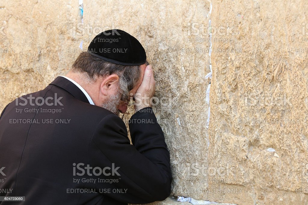 Orthodox Jewish Man at the Western Wall in Jerusalem. Israel stock photo