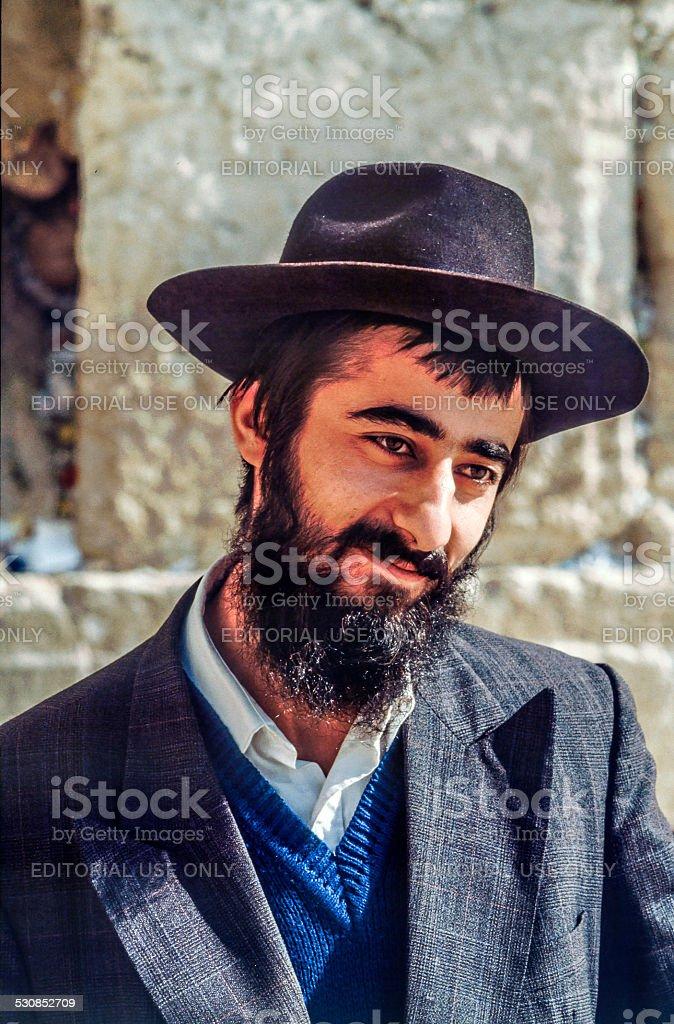 Orthodox jewish man prays at the Western Wall stock photo