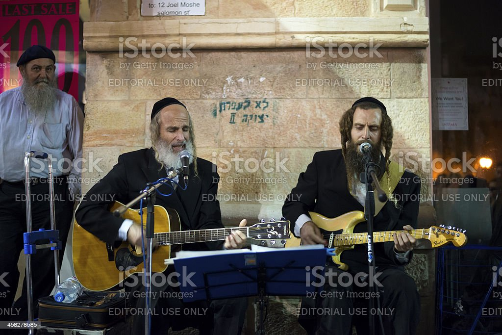 Orthodox Jews playing secular tunes in Jerusalem royalty-free stock photo