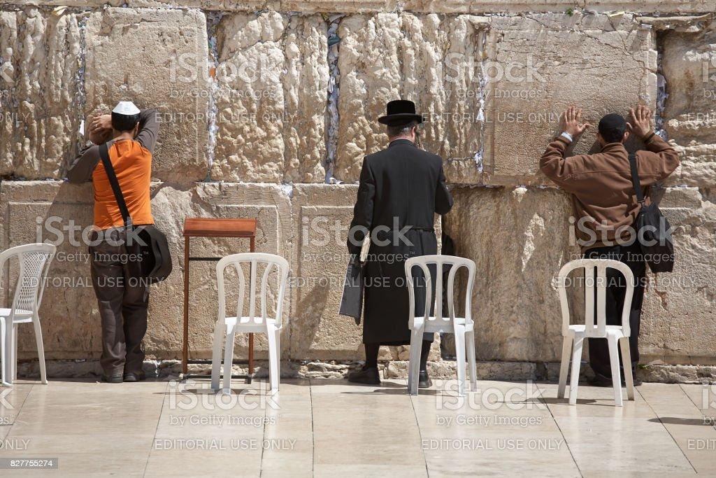 Orthodox Jews pray at the Wailing Wall stock photo