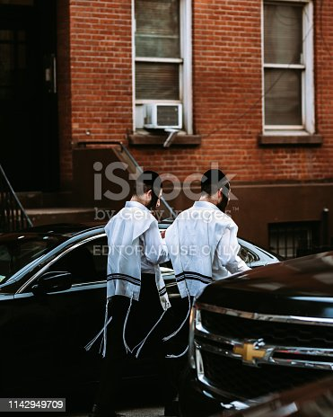 New York City, United States - April 13, 2019 - Orthodox Jews walking the streets of Chelsea near Chelsea Market in Manhattan.
