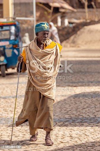 istock Orthodox monk walk on empty street of Aksum, Ethiopia 1185491132