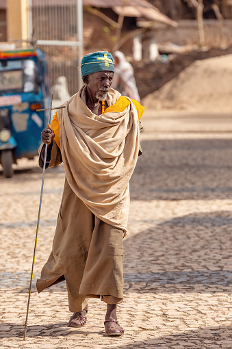 istock Orthodox monk walk on empty street of Aksum, Ethiopia 1185491132