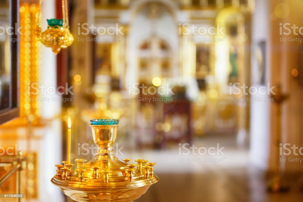 Orthodox or Christian Church inside with beautiful candles and interior stock photo