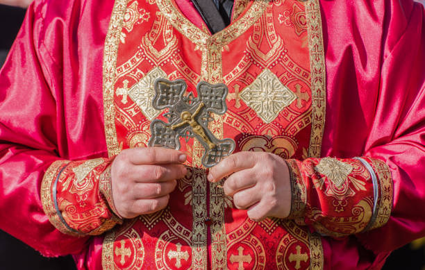 Orthodox priest holding ritual crest. stock photo