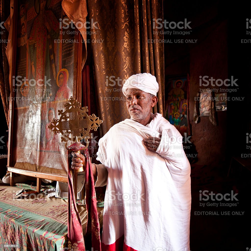 Orthodox priest standing inside a rock-hewn church,Lalibela, Ethiopia stock photo