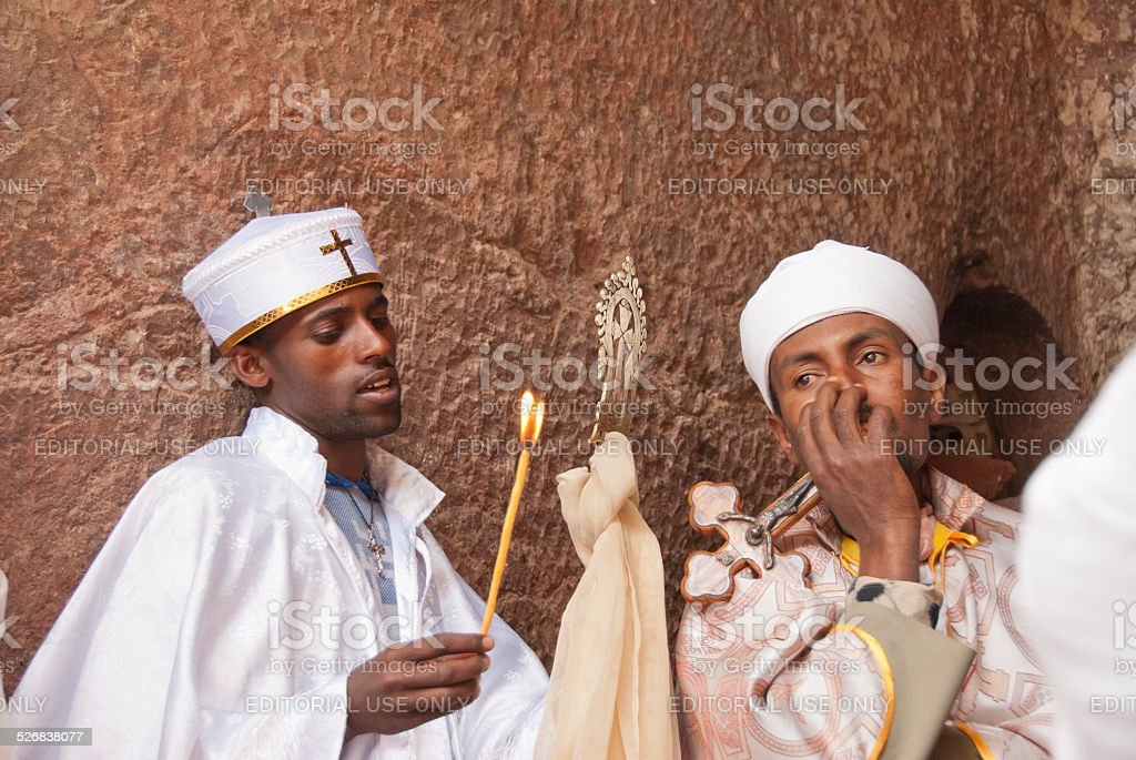 Orthodox priests wait beginning of the Christmas, Lalibela, Ethiopia. stock photo
