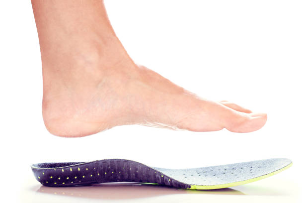 orthopedic insole and female leg orthopedic insole and female leg above it inserting stock pictures, royalty-free photos & images