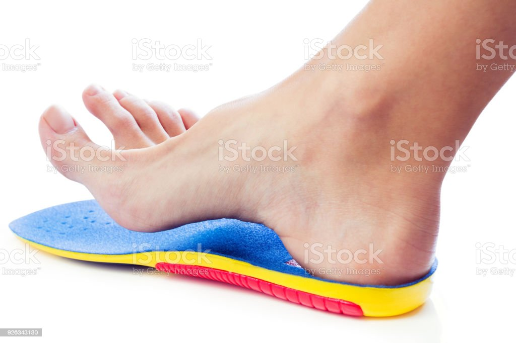 orthopedic insole and female leg stock photo