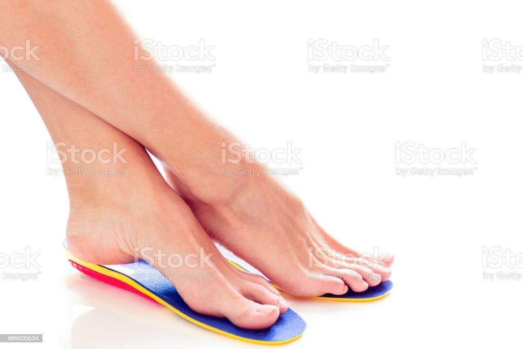 orthopedic insoles and female feet stock photo
