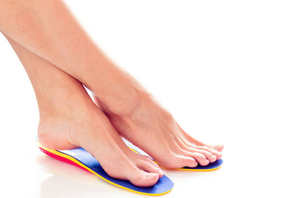 orthopedic insoles and female feet - people stencils silhouette stock photos and pictures