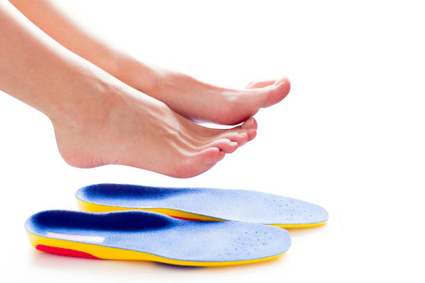 orthopedic insoles and female legs - people stencils silhouette stock photos and pictures
