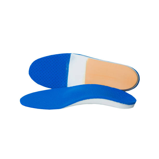 orthopedic insoles on white background orthotics on a white background. Insert in shoes to support the foot inserting stock pictures, royalty-free photos & images