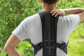 istock Orthopedic lumbar support corset products. Lumbar support belt. Posture corrector for back clavicle spine. Lumbar waist support belt. 1250415173