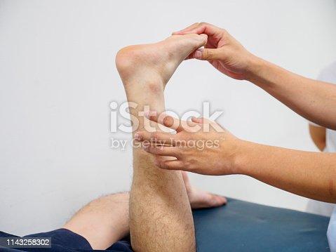 istock Orthopedic surgeon examines leg for fractures 1143258302
