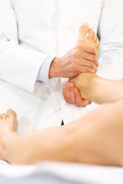 orthopedic surgeon examines the patient's foot - contributor stock pictures, royalty-free photos & images