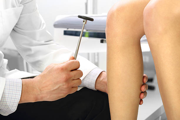 orthopedic surgeon examining the knee reflex - contributor stock pictures, royalty-free photos & images