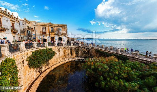 Ortigia, Italy - August 23, 2018: View of the Fountain of Arethusa in Ortigia Island, Syracuse, Italy