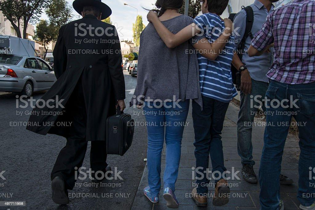 ortodox jewish man walking in the street stock photo