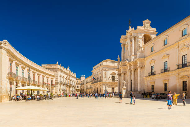 Ortygia, Italy: View of The Cathedral of Syracuse and the central square (Piazza Duomo) stock photo