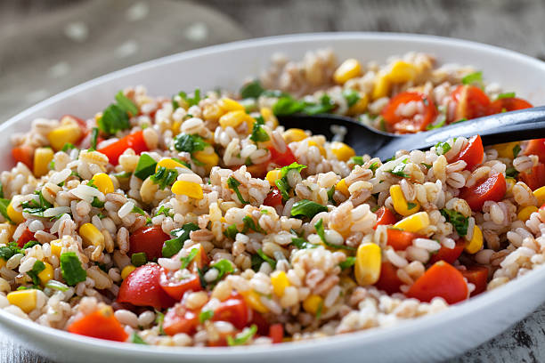 Orzo Salad. Fresh Orzo Salad Whith Tomatoes, cors and Basil. spelt stock pictures, royalty-free photos & images
