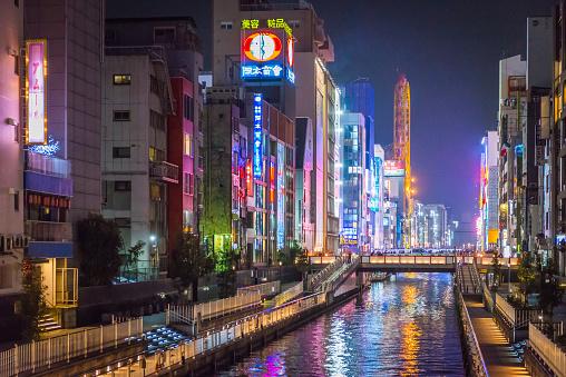 Osaka Dotonbori canal illuminated neon billboards night city skyline Japan