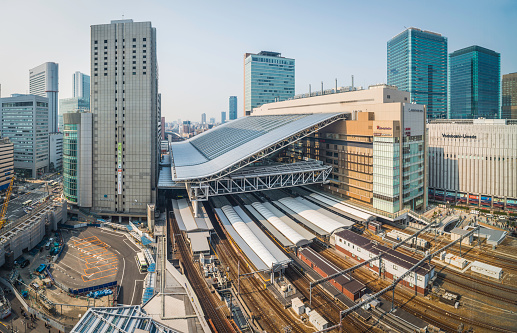 Osaka Station rail tracks platforms and skyscrapers Umeda Japan