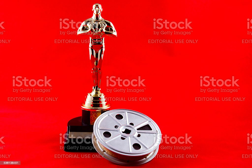 Oscar Statuette with Movie Reel stock photo