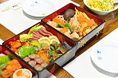 Osechi, traditional Japanese New Year food, in black lacqueware boxes