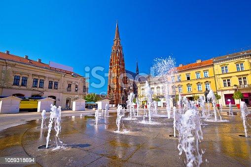 istock Osijek main square fountain and cathedral view, Slavonija region of Croatia 1059318694